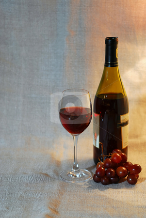 Red wine and grapes stock photo, Red wine and grapes on rustic linen background by Elena Elisseeva