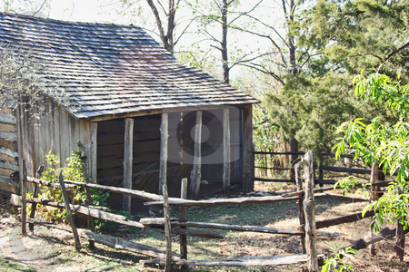 Log Cabin stock photo, An old log cabin in the woods by Kevin Tietz