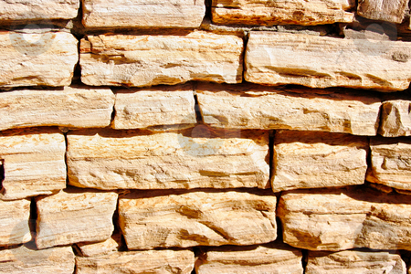 Stone Wall Texture stock photo, A stone wall texture that has been grouted together by Kevin Tietz