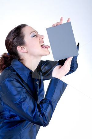 Woman with long curly hair licking a grey card stock photo, Portrait of a woman with long curly hair putting her tongue against a grey card by Frenk and Danielle Kaufmann