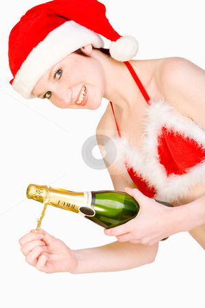 Christmas girl is holding a bottle of champagne stock photo, Beautifull girl in christmas bikini and with christmas hat is presenting a bottle of champagne. With background clipping path for your convenience by Frenk and Danielle Kaufmann
