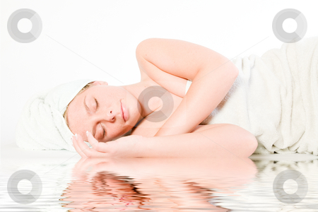 Wellness girl series laying down asleep by the water stock photo, Studio portrait of a spa girl sleeping by the pool by Frenk and Danielle Kaufmann