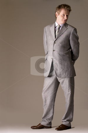 Business man with a vision stock photo, Studio portrait of a middleaged man in a business suit by Frenk and Danielle Kaufmann