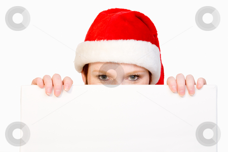 Christmas girl holding up a white sign for copyspace stock photo, Beautifull girl in christmas bikini and with christmas hat is hlding up a white sign for copy space. With background clipping path for your convenience by Frenk and Danielle Kaufmann
