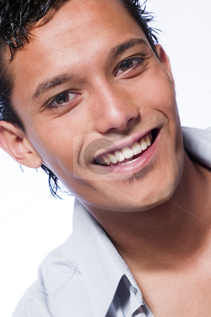 Indonesian young man smiling stock photo, Studio portrait of mixed race young man smiling by Frenk and Danielle Kaufmann