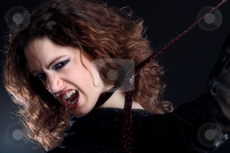 Woman with long curly hair in extasy stock photo, Portrait of a woman with long curly hair screaming in extasy by Frenk and Danielle Kaufmann