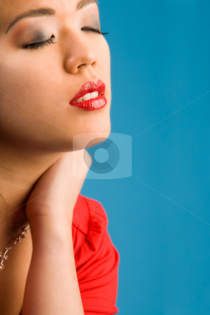 Closed glamour eyes stock photo, Young chinese girl on a blue background by Frenk and Danielle Kaufmann