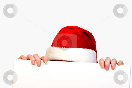 Christmas helper with copy space stock photo, Girl in christmas lingerie hiding behind a blank sign by Frenk and Danielle Kaufmann