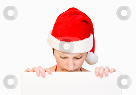 Santa girl with whiteboard stock photo, Beautiful girl in christmas bikini and with christmas hat is holding up a white sign for copy space. With background clipping path for your convenience by Frenk and Danielle Kaufmann