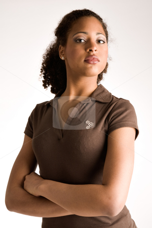 African girl with her arms crossed stock photo, African woman is waiting with her arms crossed by Frenk and Danielle Kaufmann
