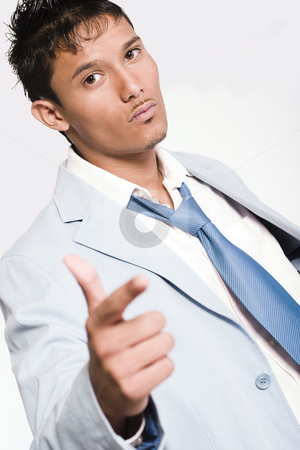 Threathening Indonesian young man stock photo, Studio portrait of mixed race young man looking threathening by Frenk and Danielle Kaufmann
