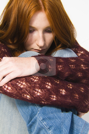 Depressed redhead stock photo, Studio portrait of a natural redhead looking depressed by Frenk and Danielle Kaufmann