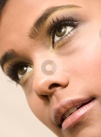 Indian beauty eyes stock photo, Studio portrait of an Indian  Indonesian beauty model  looking down by Frenk and Danielle Kaufmann
