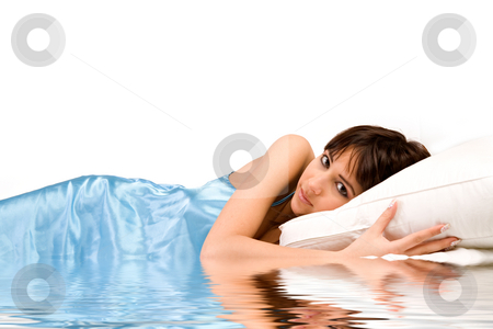 Sleeping in water stock photo, Cute girl in bed hugging her pillow on water by Frenk and Danielle Kaufmann