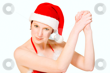 Christmas girl is celebrating stock photo, Beautifull girl in christmas bikini and christmas hat celebrating. With background clipping path for your convenience by Frenk and Danielle Kaufmann
