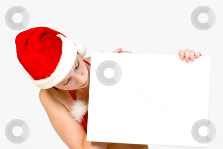 Christmas helper with copy space stock photo, Girl in christmas lingerie holding up a blank sign by Frenk and Danielle Kaufmann