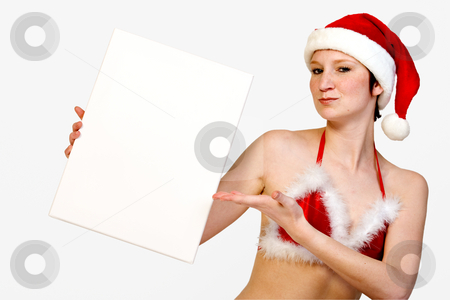 Presenting Christmas space stock photo, Beautiful girl in christmas bikini and with christmas hat is holding up a white sign for copy space. With background clipping path for your convenience by Frenk and Danielle Kaufmann