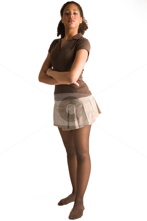 Standing with her arms crossed stock photo, Full body portrait of a african woman with her arms crossed by Frenk and Danielle Kaufmann