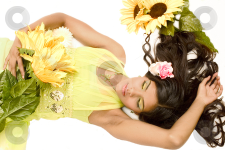Indian flower girl lying stock photo, Studio portrait of an Indian  Indonesian beauty model lying on the floor with yellow flowers by Frenk and Danielle Kaufmann