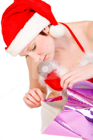 Christmas faerie unwrapping a present stock photo, Beautiful girl dressed in a christmas lingerie set unwrapping a gift box With clipping path for your convenience by Frenk and Danielle Kaufmann
