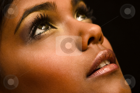 Brown Portrait of Indian woman stock photo, Studio portrait of an Indian  Indonesian beauty model looking up by Frenk and Danielle Kaufmann