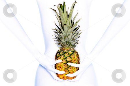White long arms and a pineapple stock photo, High-key photo of a model with white long arms holding a pineapple by Frenk and Danielle Kaufmann