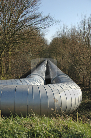 Natural gas transportion pipe stock photo, Natural gas transportion pipe lying netween the trees by Claudia Van Dijk