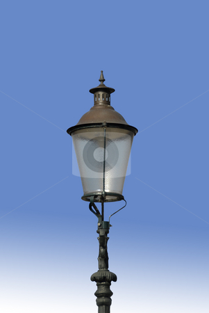 Lamppost stock photo, Oldfashioned Electric Lamppost against a blue sky by Claudia Van Dijk