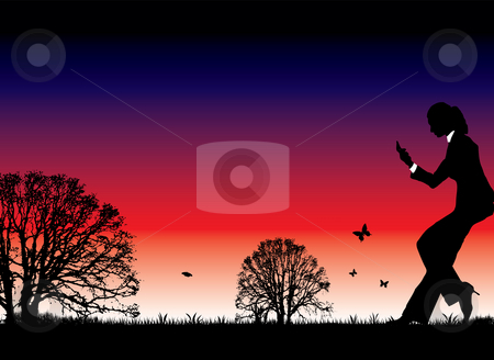 Sunset call stock photo, Natural sunset with a woman taking a business call by Michael Travers