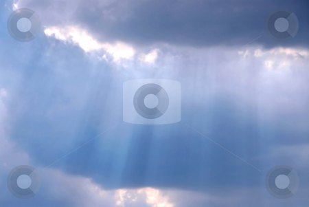 Sky sun rays stock photo, Cloudy stormy sky with sun ray breaking through by Elena Elisseeva