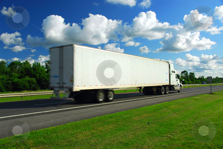 Fast moving truck stock photo, Fast moving truck with white container on highway, blurred because of motion by Elena Elisseeva