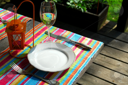 Table setting outside stock photo, Table setting outside on a deck by Elena Elisseeva