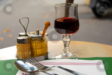 Place setting stock photo, Place setting in outdoor cafe with glass of red wine by Elena Elisseeva