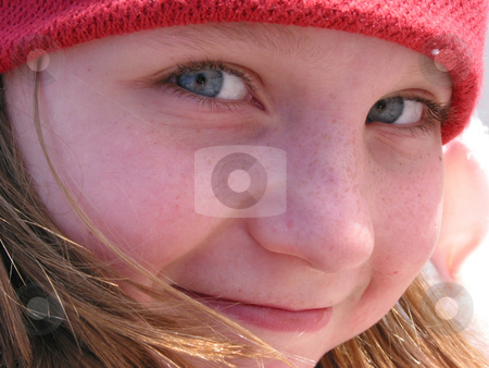 Smile girl portrait stock photo, Portrait of a smiling cute girl in a red hat by Elena Elisseeva