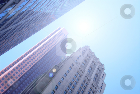 Skyscrapers stock photo, Modern and old skyscrapers downtown with blue sky by Elena Elisseeva
