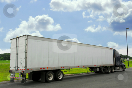 Eighteen wheeler truck stock photo, Eighteen wheeler truck on a truck stop by Elena Elisseeva