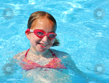 Girl swim pool stock photo, Young girl in red goggles in swimming pool by Elena Elisseeva