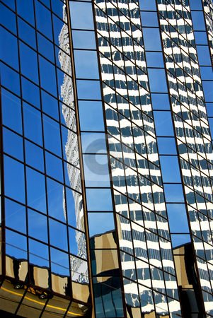 Skyscraper fragment stock photo, Reflections in a blue mirror glass wall of a skyscraper by Elena Elisseeva