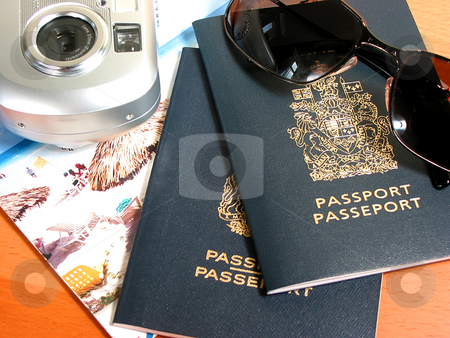 Ready to travel stock photo, Travel necessities: sunglasses, passports, camera by Elena Elisseeva