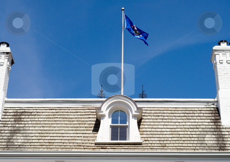 Patriot Home stock photo, Close-up view of a roof with a flag by Richard Nelson