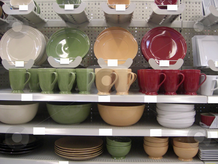 Kitchen Essentials stock photo, A variety of colorful kitchen items in different shapes, sizes and uses are neatly displayed on the shelves inside a retail store by Rebecca Mosoetsa