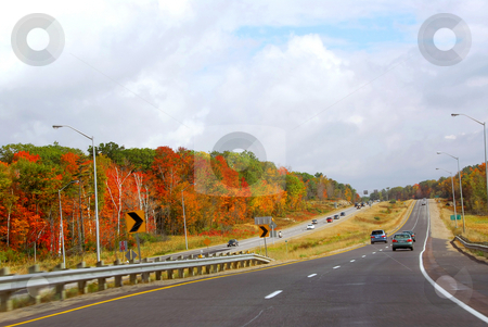 Fall highway stock photo, Divided highway with traffic in the fall by Elena Elisseeva