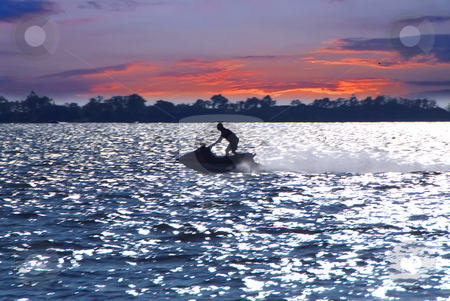 Jetski stock photo, Man on jet ski at sunset by Elena Elisseeva