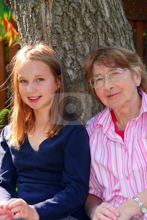 Family generations stock photo, Family generations - portrait of granddaugher and grandmother by Elena Elisseeva
