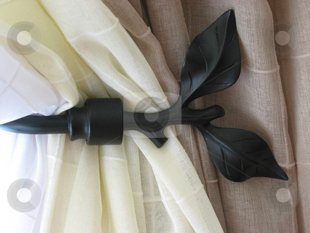 Window decor detail stock photo, Detail of window decor, curtains with black metal curtain holder by Elena Elisseeva