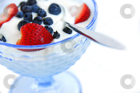 Yogurt in glass bowl stock photo, Healthy breakfast of yogurt and berries by Elena Elisseeva