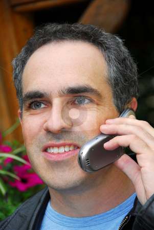 Man phone stock photo, Attractive man talking on cell phone outside by Elena Elisseeva