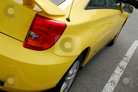 Yellow sports car stock photo, Yellow sports car, rear view by Elena Elisseeva