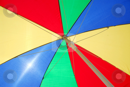 Beach umbrella stock photo, Beach umbrella backgound by Elena Elisseeva