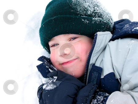 Child fun winter stock photo, Young boy playing in fresh powder snow by Elena Elisseeva